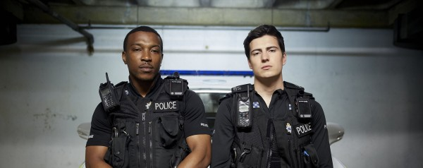 Programme Name: Cuffs - TX: n/a - Episode: n/a (No. n/a) - Picture Shows:  PC Ryan Draper (ASHLEY WALTERS), PC Jake Vickers (JACOB IFAN) - (C) Tiger Aspect - Photographer: Tiger Aspect