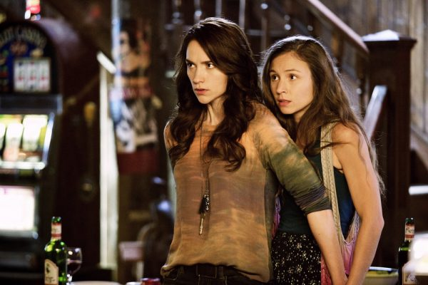 "WYNONNA EARP -- ""Keep the Home Fires Burning"" Episode 102 -- Pictured: (l-r) Melanie Scrofano as Wynonna Earp, Dominique Provost-Chalkley as Waverly Earp -- (Photo by: Michelle Faye/Syfy/Wynonna Earp Productions)"