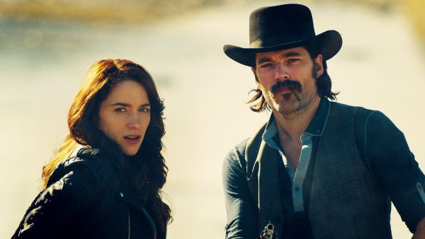 "WYNONNA EARP -- ""The Blade"" Episode 104 -- Pictured: (l-r) Melanie Scrofano as Wynonna Earp, Tim Rozon as Doc Holliday -- (Photo by: Syfy/Wynonna Earp Productions)"