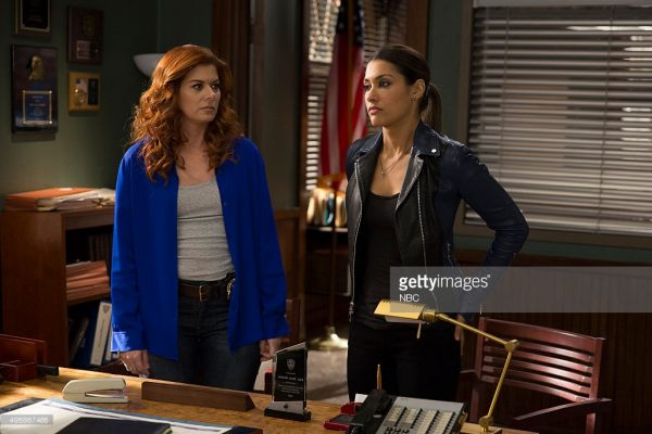 """THE MYSTERIES OF LAURA -- """"The Mystery of the Ghost in the Machine"""" Episode 208 -- Pictured: (l-r) Debra Messing as Laura Diamond, Janina Gavankar as Meredith Bose -- (Photo by: Christopher Saunders/NBC/NBCU Photo Bank)"""