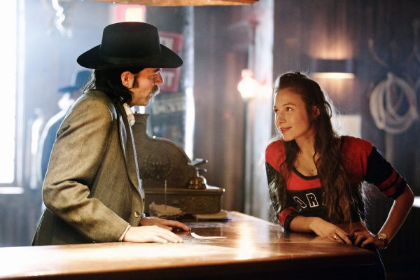 "WYNONNA EARP -- ""Keep the Home Fires Burning"" Episode 102 -- Pictured: (l-r) Tim Rozon as Doc Holliday, Dominique Provost-Chalkley as Waverly Earp -- (Photo by: Michelle Faye/Syfy/Wynonna Earp Productions)"