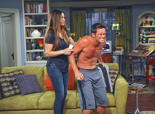 """Dirty Talk"" -- Russell tries to get out of his marriage to an overly enthused Liz, who tries to make it work, while Jeff attempts to engage Audrey in dirty talk, on the sixth season premiere of RULES OF ENGAGEMENT, Saturday, Oct. 8 (8:00-8:30 PM, ET/PT) on the CBS Television Network. Pictured here, Jen (Bianca Kajlich) tries to calm AdamÕs (Oliver Hudson) sunburn.Photo: RON P. JAFFE/CBS ©2011 CBS BROADCASTING INC. All Rights Reserved. #ROE"